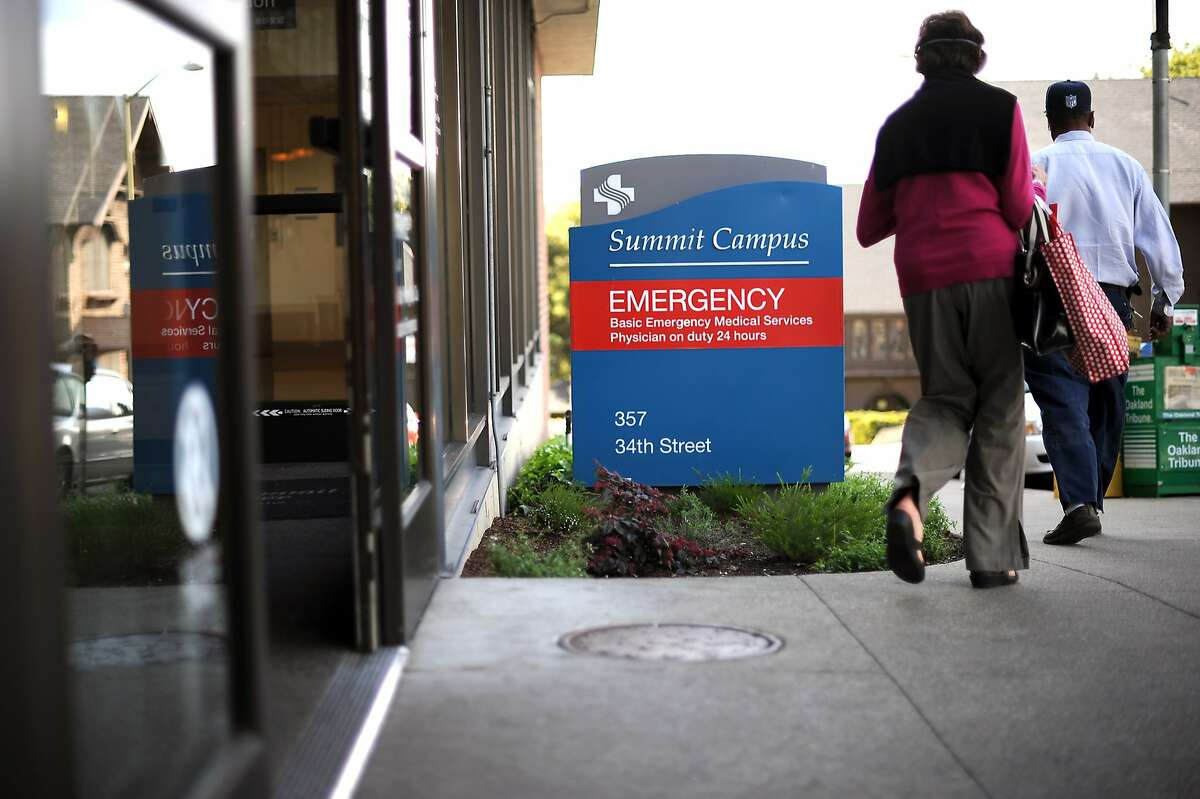 People are seen exiting the emergency room at Alta Bates Summit Hospital in Oakland, CA Friday March 29th, 2013. Alta Bates Summit Medical Center has the highest rate of 911 calls in Oakland, mostly for psychiatric 5150 holds.