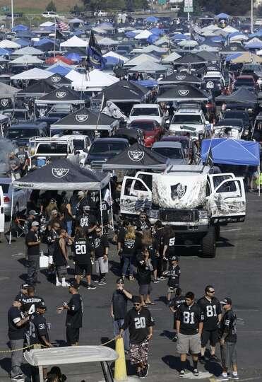 Oakland Raiders fans tailgate outside O.co Coliseum before ...