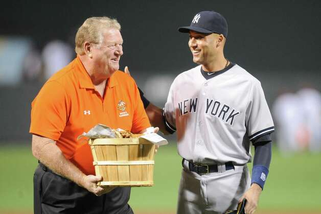 BALTIMORE, MD - SEPTEMBER 14: Former Baltimore Orioles player Boog Powell presents Derek Jeter #2 of the New York Yankees with a basket of crabs as a farewell gift for his last game in Baltimore at before a baseball game on September 14, 2014 at Oriole Park at Camden Yards in Baltimore, Maryland. (Photo by Mitchell Layton/Getty Images) ORG XMIT: 477589921 Photo: Mitchell Layton / 2014 Getty IMages