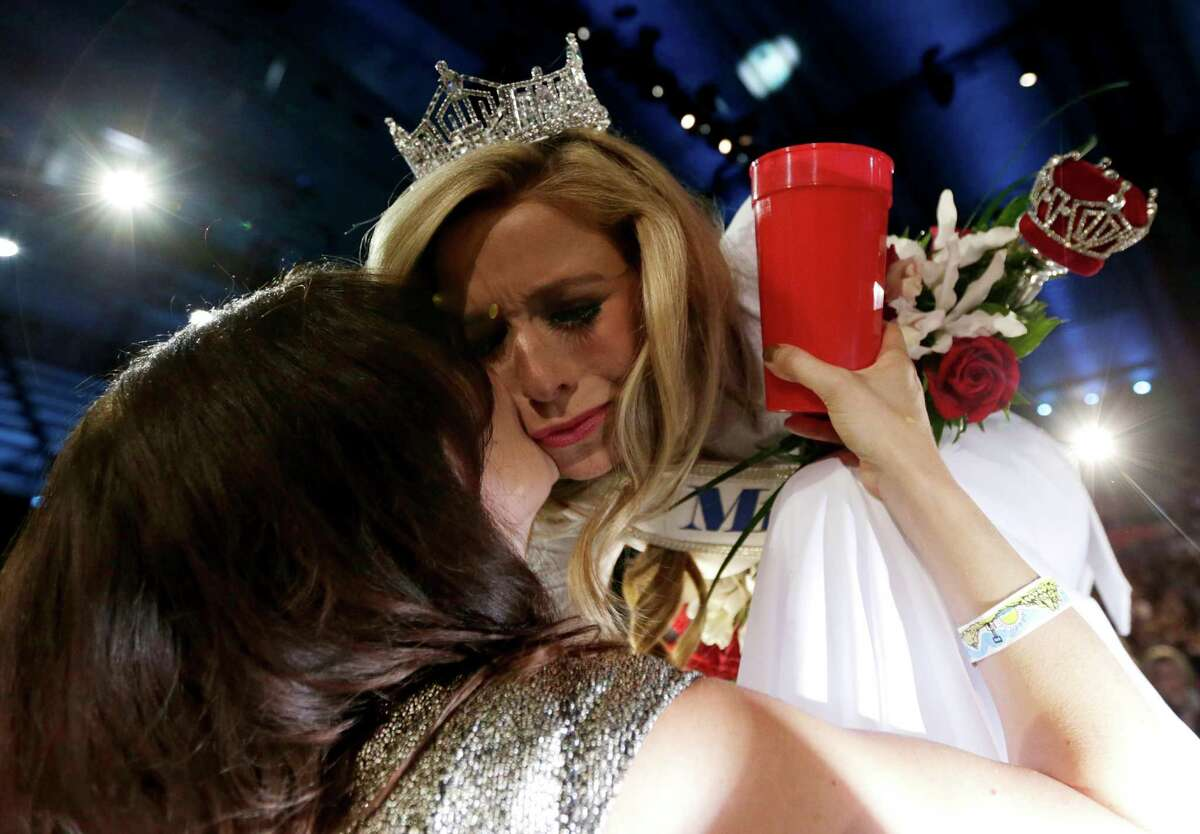 Miss New York Kira Kazantsev, right, gets a kiss from her mother, Julia Kazantsev, after Kira Kazantsev was crowned Miss America 2015 during the Miss America 2015 pageant, Sunday, Sept. 14, 2014, in Atlantic City, N.J.