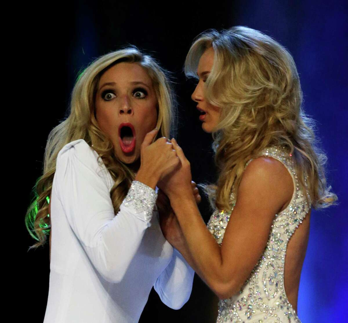 Miss New York Kira Kazantsev, left, gasps after she was named Miss America 2015 as she holds hands with Miss Virginia Courtney Paige Garrett during the Miss America 2015 pageant, Sunday, Sept. 14, 2014, in Atlantic City, N.J.