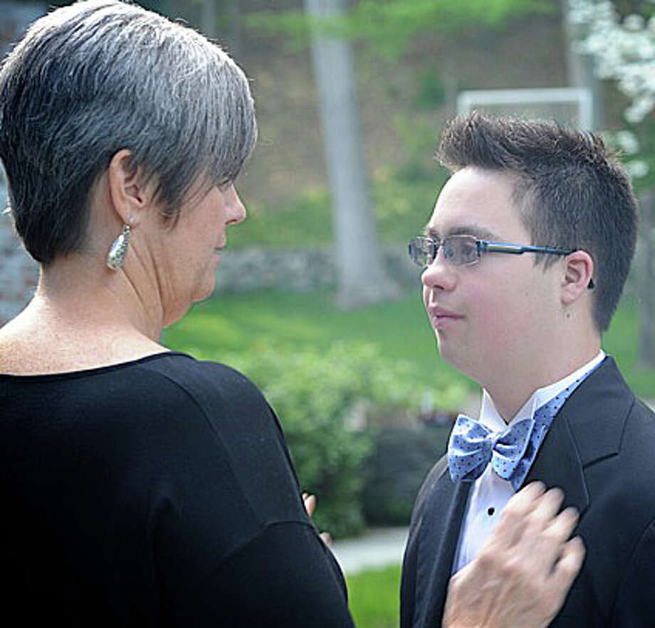 Chris Lopes of Fairfield with his mother, Kathy, before his junior prom at Fairfield Warde High School last May. Chris has been selected to appear in a video to be shown in Times Square by the National Down Syndrome Society. Photo: Contributed Photo / Fairfield Citizen