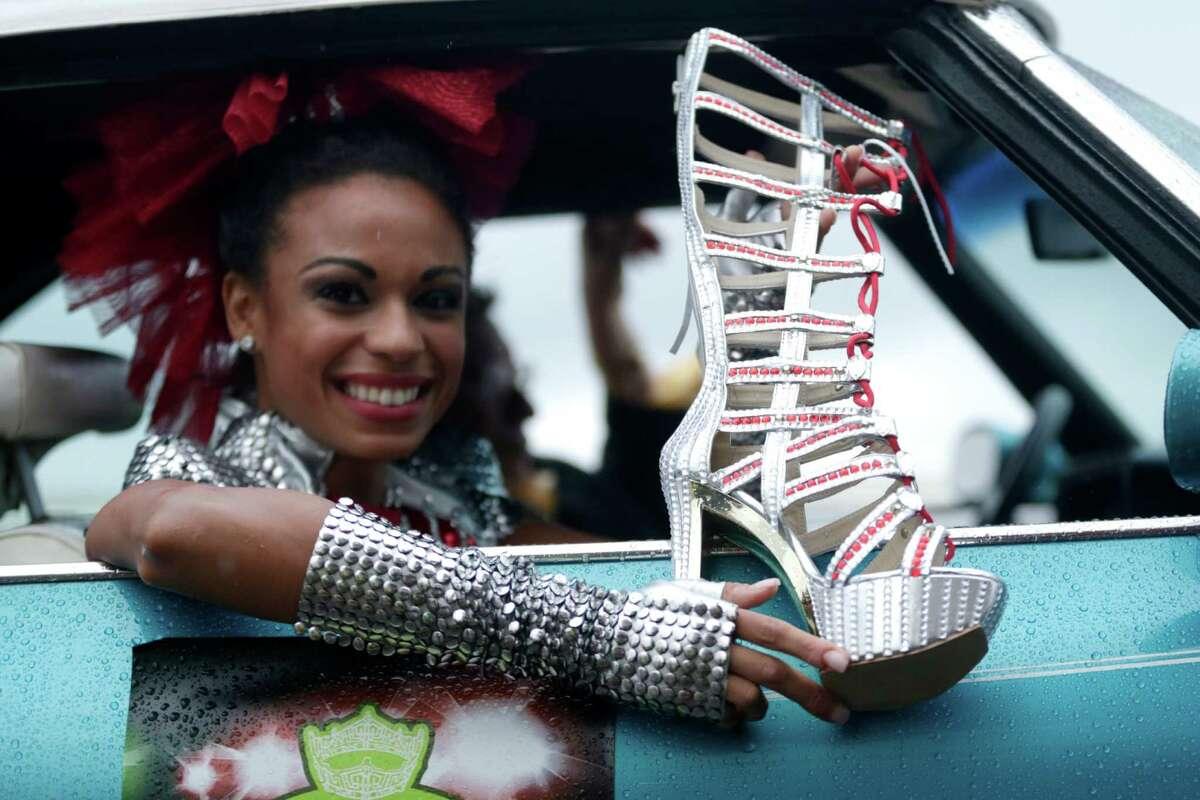 Miss New Jersey Cierra Kaler-Jones displays her shoe during the Miss America Shoe Parade at the Atlantic City boardwalk, Saturday, Sept. 13, 2014, in Atlantic City, N.J.