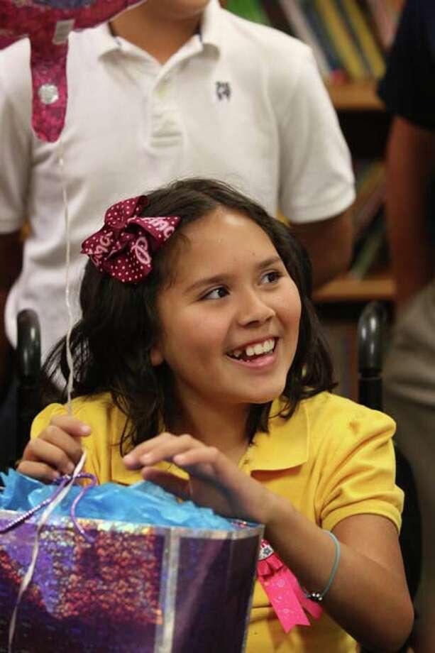 Ali celebrates her birthday with classmates at school photo by Jason Dunn Photo: ªªHPˇ