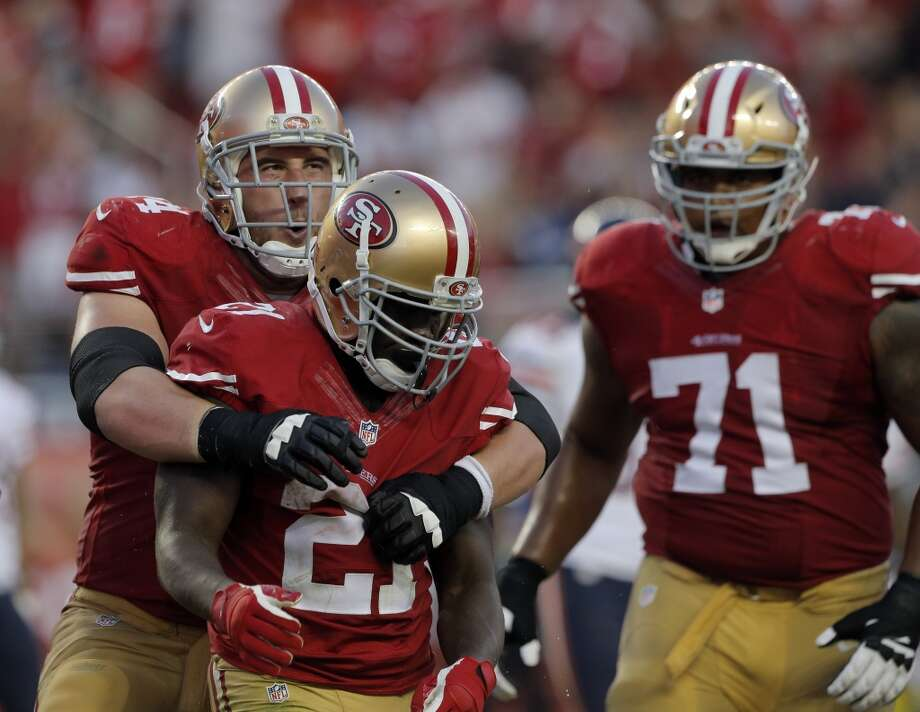 Joe Staley (74) hugs Frank Gore (21) after Gore scored a touchdown in the first half as the 49ers played the Chicago Bears at Levi's Stadium in Santa Clara, Calif., on Sunday, September 14, 2014. Photo: The Chronicle