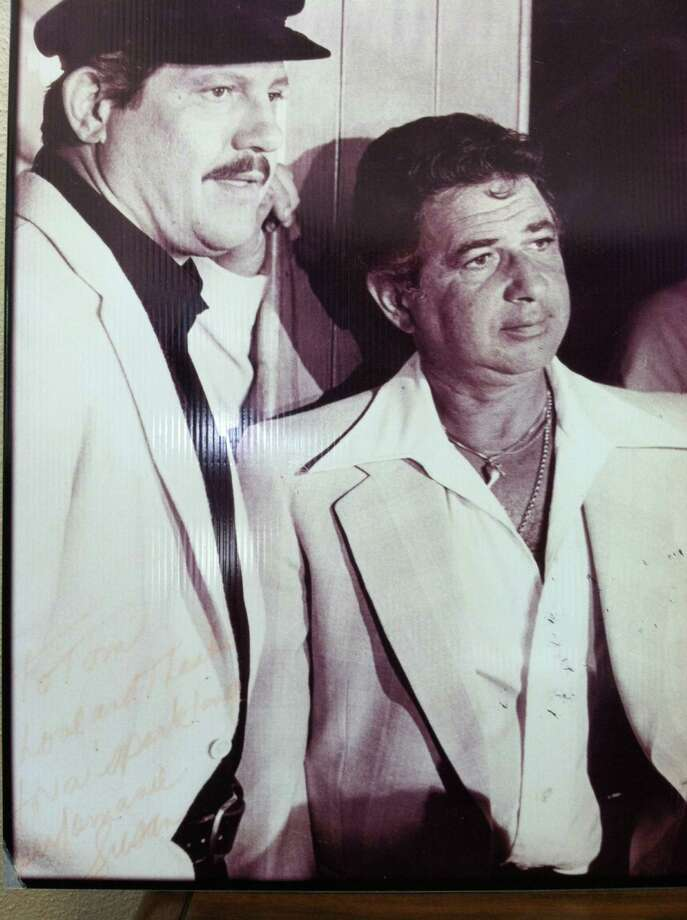 Alex Karras, left, and his manager Tom Vance, of Beaumont, look 1970s-spiffy. Karras, 77, an NFL great in the late 1950s and early 1960s, died Wednesday. He had connections to Beaumont, acting in a movie as husband George Zaharias to Beaumont's Babe Didrikson Zaharias, Olympic and golfing champion. Courtesy photo Photo: Photo Provided By Tom Vance
