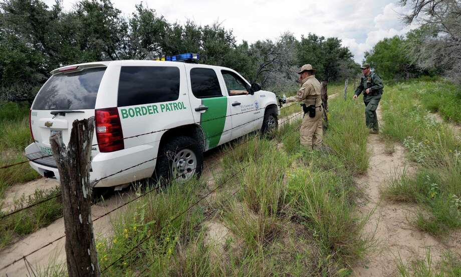 In this Sept. 5, 2014 photo, a U.S. Customs and Border Protection Air and Marine agents and U.S. Customs and Border Protection agents compare notes as they patrol near the Texas-Mexico border, near McAllen, Texas. Since illegal immigration spiked in the Rio Grande Valley this summer, the Border Patrol has dispatched more agents, the Texas Department of Public Safety has sent more troopers and Gov. Rick Perry deployed as many as 1,000 guardsmen to the area. Photo: Eric Gay, AP / AP