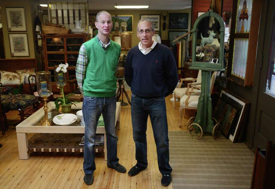 Ian Durkin, left, and Gary Pelletier, store owners and partners, pose inside On the Hunt in New Milford, Conn. Saturday, Sept. 13, 2014.  On the Hunt is a new lifestyle design store featuring a variety of items like furniture, artwork, glass and fine china for the home. Photo: Tyler Sizemore / The News-Times