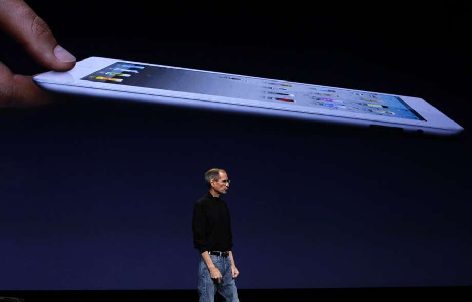 "Apple CEO Steve Jobs unveils the iPad 2 in 2011. When reporter Nick Bilton asked Steve Jobs in 2010 if his children loved the iPad, Jobs told him  ""They haven't used it. We limit how much technology our kids use at home."" Photo: Paul Chinn, The Chronicle"