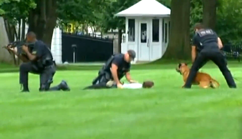 Screen grab from Fox News showing Jeffrey Grossman, 26, being arrested after entering the White House grounds Sept. 11, 2014, in Washington, D.C. The Pokemon fan who jumped over the White House fence wearing a Pikachu hat and carrying a stuffed doll of the character was known for similar behavior in Rensselaer and East Greenbush. (Fox News)
