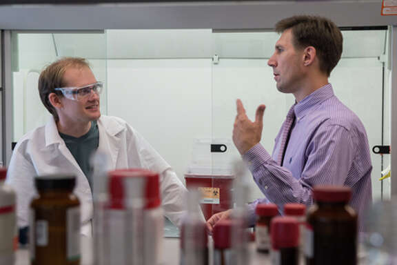 """Rice chemist  Eugene Zubarev, right, with graduate student Paul Derry. Zubarev won a  rare two-year grant funding extension for """"special creativity"""" from the NSF. (Courtesy of Rice University)"""