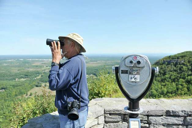 Luciano Toffolo of Rotterdam uses binoculars to look for hawks at John Boyd Thacher State Park during the Helderberg Escarpment Hawk Watch on Monday, Sept. 15, 2014, in New Scotland, N.Y.   (Paul Buckowski / Times Union) Photo: Paul Buckowski / 00028617A