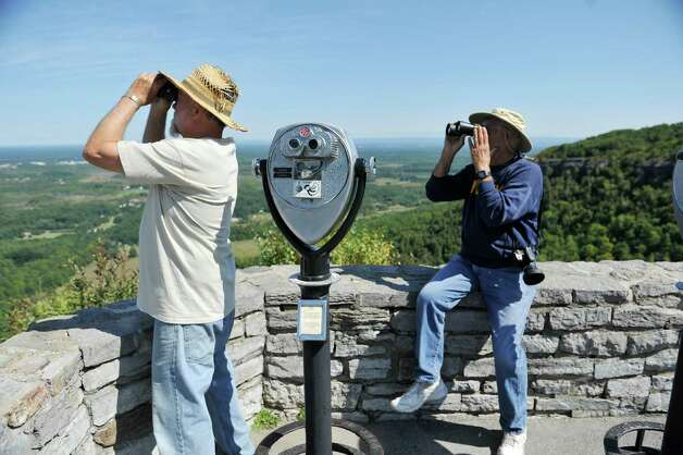 Will Aubrey, left, of Northville, and Luciano Toffolo of Rotterdam use binoculars to identify a hawk at John Boyd Thacher State Park during the Helderberg Escarpment Hawk Watch on Monday, Sept. 15, 2014, in New Scotland, N.Y.   (Paul Buckowski / Times Union) Photo: Paul Buckowski / 00028617A