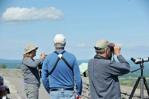 Marian Sole, left, of Valatie; Tom Williams, center, of Colonie, and Don Gresens of Schenectady scan the sky for birds at John Boyd Thacher State Park during the Helderberg Escarpment Hawk Watch on Monday, Sept. 15, 2014, in New Scotland, N.Y.   (Paul Buckowski / Times Union) Photo: Paul Buckowski / 00028617A