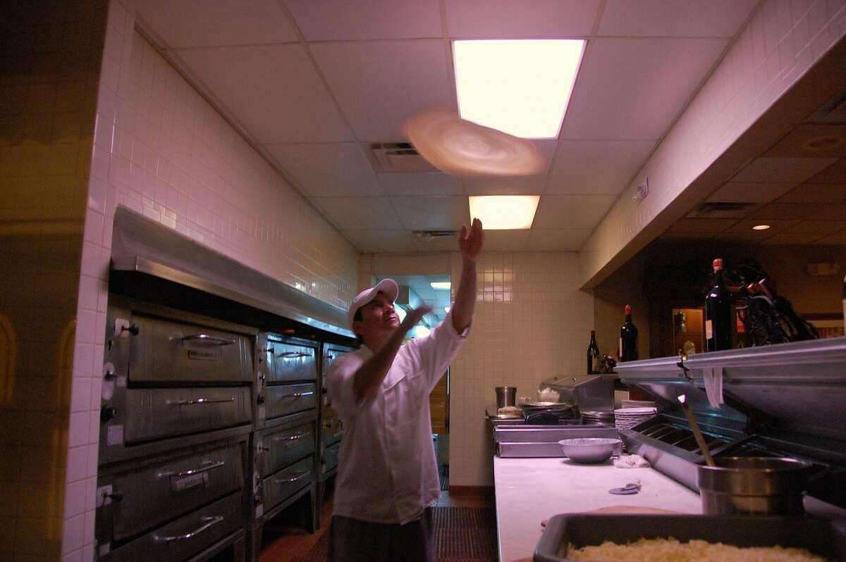 """Eli is the one who throws the pizza. """"I wish I could,"""" said Antonella, who's worked at the restaurant 16 years. """"They make it look easy."""""""