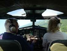 """Pilots Bob Davis and Lorraine Morris fly the Boeing B-17 Flying Fortress bomber aircraft after taking off at the Waterbury Oxford Airport in Oxford, Conn. Monday, Sept. 15, 2014.  The airport is offering rides in the historic """"Aluminum Overcast"""" World War II plane."""