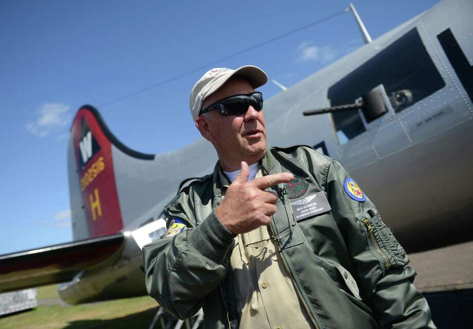 "Crew Chief Rick Reynolds talks about the Boeing B-17 Flying Fortress bomber aircraft at the Waterbury Oxford Airport in Oxford, Conn. Monday, Sept. 15, 2014.  The airport is offering rides in the historic ""Aluminum Overcast"" World War II plane. Photo: Tyler Sizemore / The News-Times"