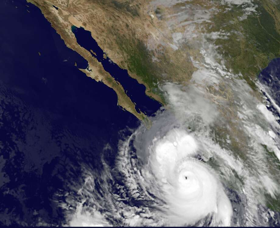 This satellite image provided by NOAA shows category four Hurricane Odile taken at 5:45 a.m. EDT Sunday Sept. 14, 2014. The rapidly strengthening Hurricane Odile intensified Saturday night and appeared headed for a possible close brush with the southern end of Mexico's Baja California peninsula. At 5 a.m. EDT Odile had maximum sustained winds of 135 mph and was moving north-northwest at 15 mph. (AP Photo/NOAA) Photo: Associated Press