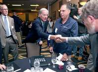 Connecticut gubernatorial candidate Tom Foley, center, shakes hands with John Simone of the CT Main St. Center at a Transportation Forum in North Haven, Connecticut, on Monday, Sept. 15, 2014.