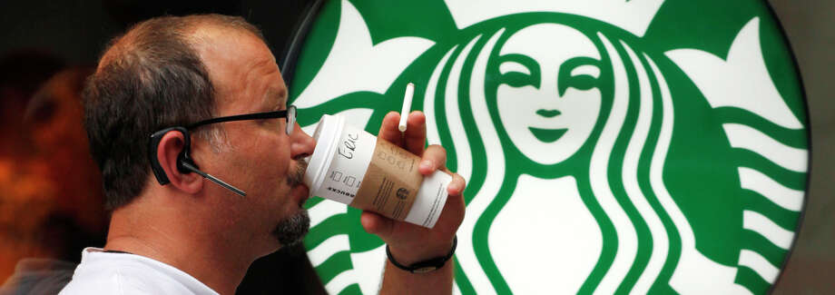 Starbucks wants to make it easier to order and pay for drinks through its mobile app. Photo: Mark Lennihan / Associated Press / AP