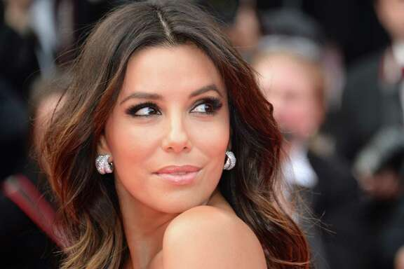 """CANNES, FRANCE - MAY 17:  Actress Eva Longoria attends the """"Saint Laurent"""" premiere during the 67th Annual Cannes Film Festival on May 17, 2014 in Cannes, France.  (Photo by Traverso/L'Oreal/Getty Images)"""