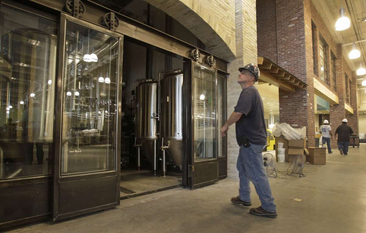 The fermentation cellar tanks can be seen through glass doors as construction continues at Whole Foods Market, 1700 Post Oak, shown Thursday, Sept. 11, 2014, in Houston. Dave Ohmer will be the brewmaster. ( Melissa Phillip / Houston Chronicle )