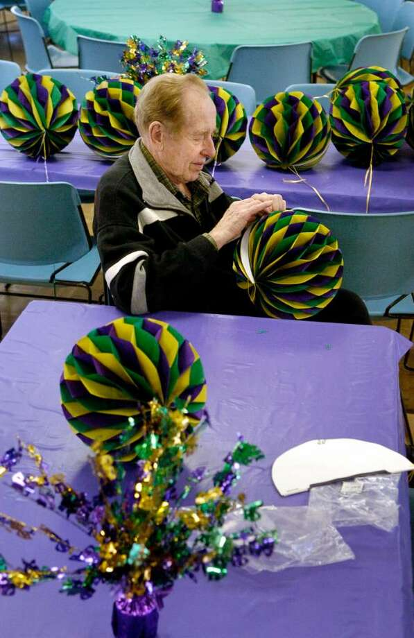 Geza Ziegler, a parishioner at St. Leo Church in Stamford, Conn., helps with decorating the hall for Mardi Gras dinner on Monday February 15,2010 Photo: Dru Nadler / Stamford Advocate