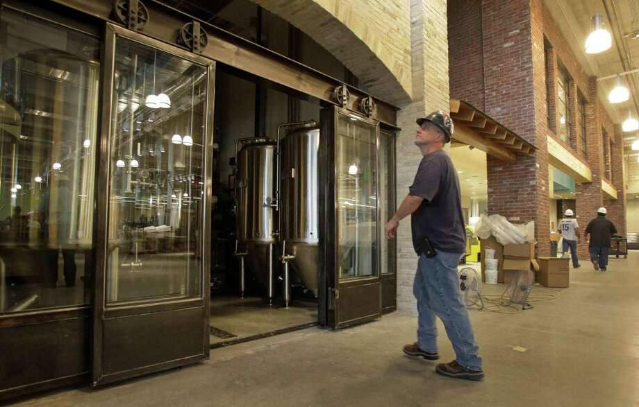 The fermentation tanks for a brewpub have been installed as construction continues at a Whole Foods Market for BLVD Place in the Galleria area. The pub will have 20 beer taps. Photo: Melissa Phillip, Staff / © 2014  Houston Chronicle