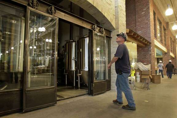 The fermentation tanks for a brewpub have been installed as construction continues at a Whole Foods Market for BLVD Place in the Galleria area. The pub will have 20 beer taps.