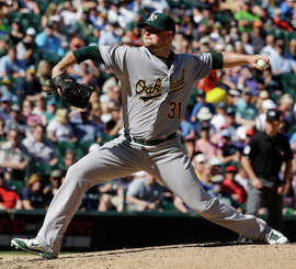 A's GM Billy Beane is thankful he's got left-hander Jon Lester, above, who's lined up to start a Sept. 30 wild-card game.