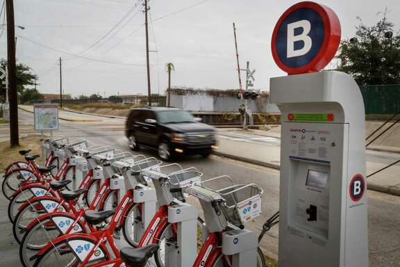 Houston's B-Cycle program opened its 29th kiosk just before Christmas in front of Clayton Homes, a city housing authority development, Monday, Dec. 30, 2013, in Houston.  ( Michael Paulsen / Houston Chronicle )