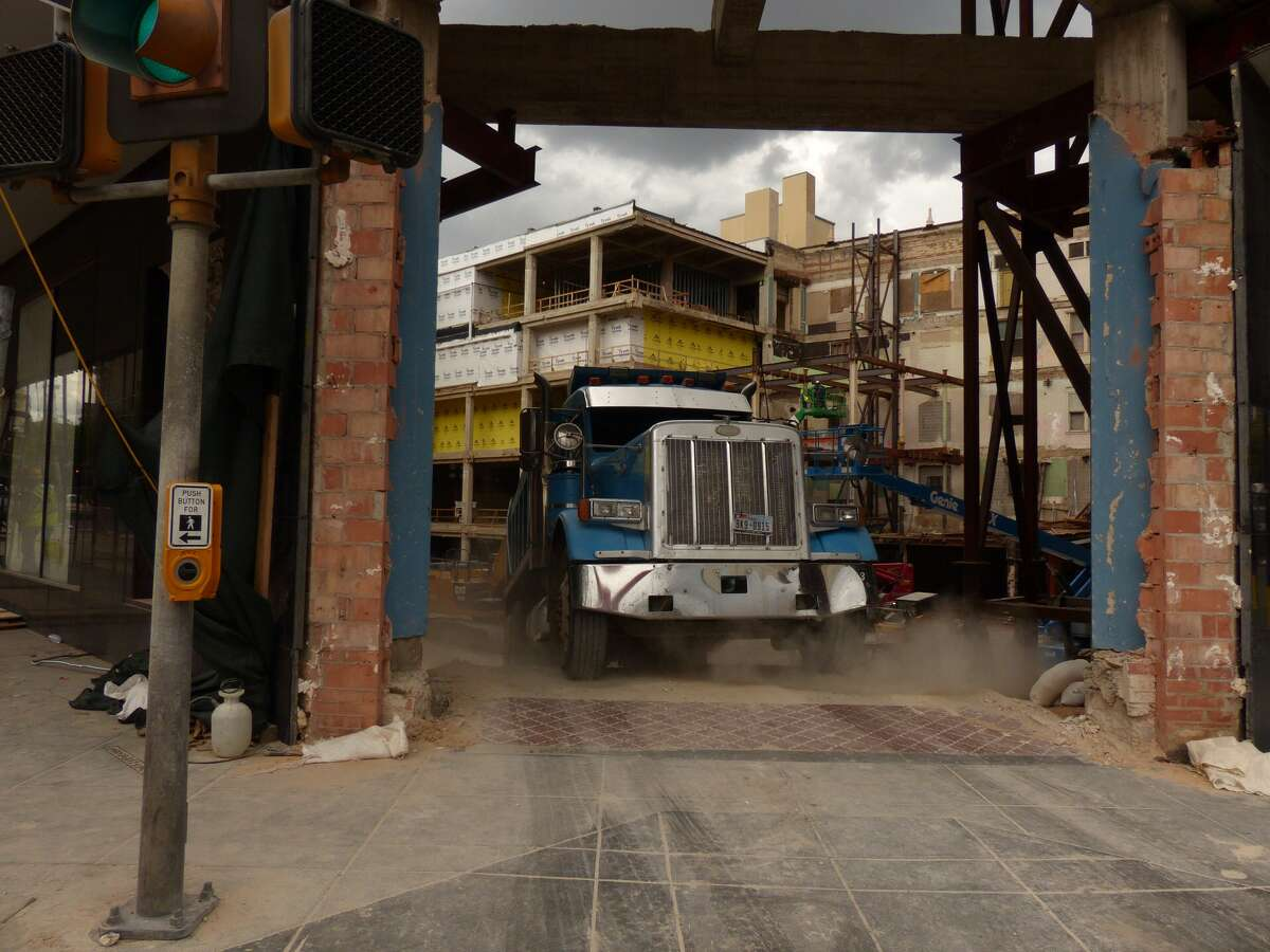 A construction truck leaves the site of the old Joske's in downtown San Antonio as doors are momentarily opened on Friday, September 12, 2014.