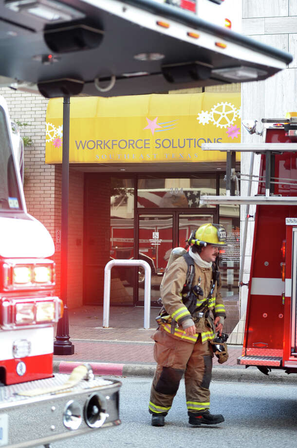 Firefighters responded to the Texas Workforce Solutions when smoke was spotted in the building Late Monday afternoon. The cause of the smoke was later determined to be from a compressor. The building was evacuated and no injuries were reported.  Photo taken Monday, September 15, 2014 Guiseppe Barranco/@spotnewsshooter Photo: Guiseppe Barranco, Photo Editor