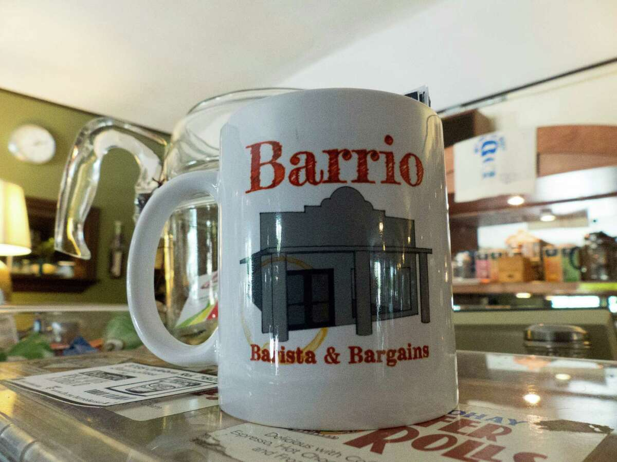 A cup is emblazoned with the logo of Barrio Barista & Bargains.
