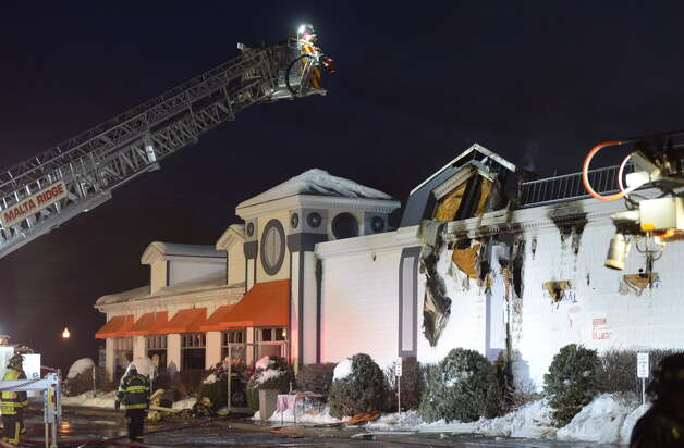 Firefighters from various departments in Saratoga County look for remaining fire after the Dunkin' Donuts was heavily damaged Thursday morning, Dec. 19, 2013, on Dunning Street in Malta, N.Y.    (Skip Dickstein / Times Union) Photo: Skip Dickstein