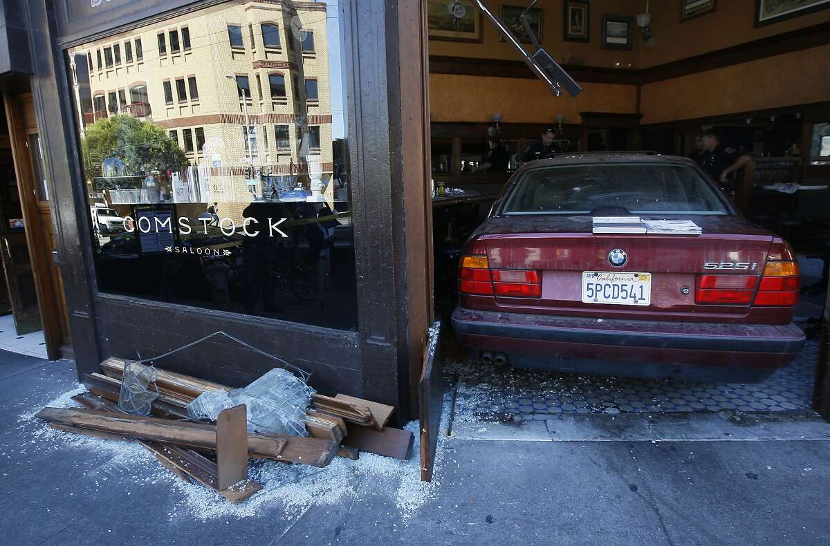 A BMW sits inside Comstock Saloon on the corner of Columbus and Pacific Avenue in San Francisco, Calif. after the driver crashed through the front doors Monday, September 15, 2014