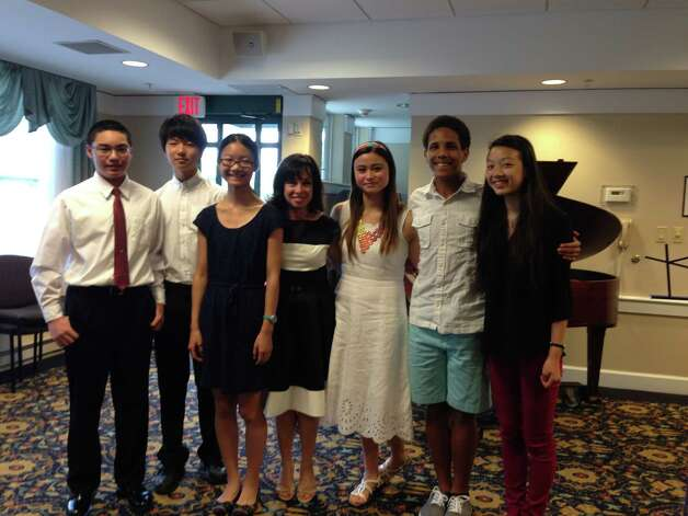 Six young musicians participated in a Sept. 6 classical music concert at the Glen Eddy retirement home in Niskayuna. Jen Lucius, the 17-year-old high school who organized the event, said the students enjoyed playing for the retirement residents, who loved the concert in return. From left, tare as follows: JT Sterle, Dan Kim, Leechen Zhu, Bella Brusilovsky (piano teacher), Jen Lucius, Bijan Moore and  Lesley Santos. (Jen Lucius)