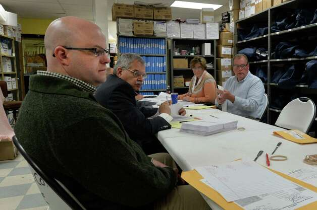 Republican candidate for Rensselaer County DA Joel Abelove, left, watches as a recount of ballots from the Independent Party took place in the Rensselaer County Board of Elections Monday, Sept. 15, 2014, in Troy, N.Y.    (Skip Dickstein/Times Union) Photo: SKIP DICKSTEIN / 00028587A