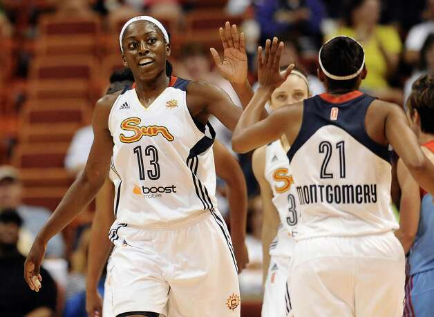 Connecticut Sun's Chiney Ogwumike high-fives with Sun's Renee Montgomery during the first half of a WNBA basketball game against the Atlanta Dream, Sunday, Aug. 17, 2014, in Uncasville, Conn. (AP Photo/Jessica Hill) ORG XMIT: CTJH102 Photo: Jessica Hill / FR125654 AP