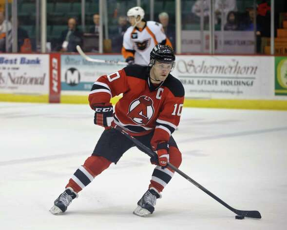 Albany Devil Rod Pelley handles the puck during a game Sunday afternoon on April 6, 2014, at the Glens Falls Civic Center. Photo By Eric Jenks Photo: Eric Jenks / Eric Jenks 2012