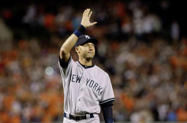 New York Yankees shortstop Derek Jeter acknowledges spectators during a ceremony honoring his career, before the Yankees' baseball game against the Baltimore Orioles, Sunday, Sept. 14, 2014, in Baltimore. Jeter was making his final regular-season appearance as a Yankee at Oriole Park at Camden Yards. (AP Photo/Patrick Semansky) ORG XMIT: MDPS103 Photo: Patrick Semansky / AP