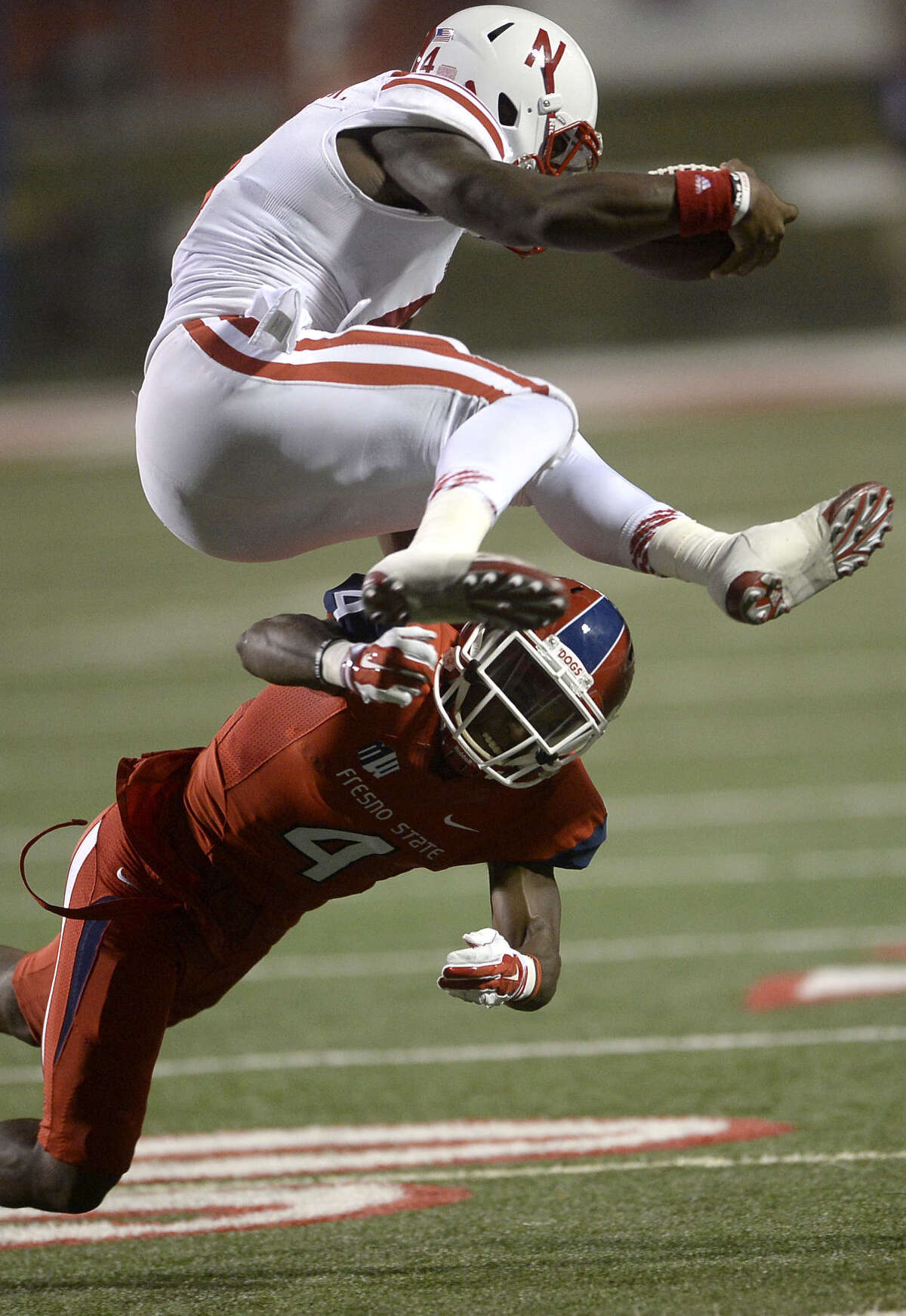 Nebraska QB Tommy Armstrong Jr. showed his running ability Saturday by hurdling over Fresno State's Shannon Edwards.