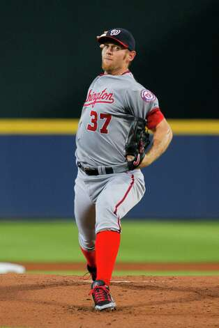 Washington Nationals starting pitcher Stephen Strasburg (37) delivers in the first inning of a baseball game against the Atlanta Braves Monday, Sept. 15, 2014, in Atlanta. (AP Photo/Todd Kirkland) ORG XMIT: GATK102 Photo: Todd Kirkland / FR170762 AP