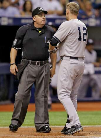 Home plate umpire Marty Foster, left, ejects New York Yankees' Chase Headley for arguing during the seventh inning of a baseball game against the Tampa Bay Rays Monday, Sept. 15, 2014, in St. Petersburg, Fla. (AP Photo/Chris O'Meara)  ORG XMIT: SPD113 Photo: Chris O'Meara / AP