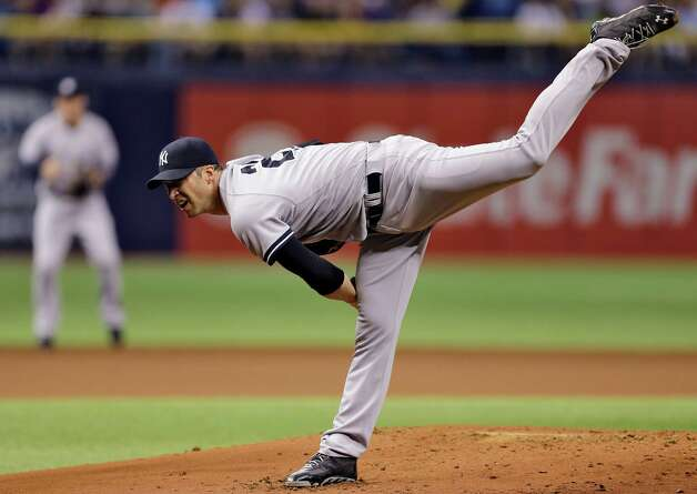 New York Yankees starting pitcher Chris Capuano follows through on his delivery to the Tampa Bay Rays during the first inning of a baseball game Monday, Sept. 15, 2014, in St. Petersburg, Fla. (AP Photo/Chris O'Meara)  ORG XMIT: SPD105 Photo: Chris O'Meara / AP
