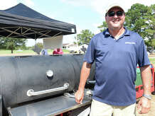 Arthur Head with Wholesale Electric manned the grill at the 25th annual Exxon Mobil March of Dimes Golf Tournament, held Monday at the Beaumont Country Club. Volunteers say they expect to meet this year's goal of raising $150,000, and also noted that Moncla has been catering the event since it began. Photo taken Saturday, September 13, 2014 Kim Brent/@kimbpix
