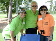 From left, volunteers Melinda McNeely, Mary Richardson, and Lisa Miller at the 25th annual Exxon Mobil March of Dimes Golf Tournament, held Monday at the Beaumont Country Club. Volunteers say they expect to meet this year's goal of raising $150,000, and also noted that Moncla has been catering the event since it began. Photo taken Saturday, September 13, 2014 Kim Brent/@kimbpix