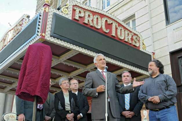 Times Union Editor Rex Smith talks about the newly renovated and modernized marquee at an unveiling at Proctor's on Monday, Sept. 15, 2014 in Schenectady, N.Y. Times Union was one of the sponsors of the marquee. Proctors CEO Philip Morris, right, Mayor Gary McCarthy, second from right, and other officials and sponsors stand behind Smith. (Lori Van Buren / Times Union) Photo: Lori Van Buren / 00028616A