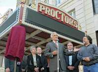 Times Union Editor Rex Smith talks about the newly renovated and modernized marquee at an unveiling at Proctor's on Monday, Sept. 15, 2014 in Schenectady, N.Y. Times Union was one of the sponsors of the marquee. Proctors CEO Philip Morris, right, Mayor Gary McCarthy, second from right, and other officials and sponsors stand behind Smith. (Lori Van Buren / Times Union)