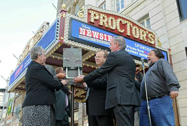 Proctors CEO Philip Morris, right, calls for the switch to be turned on for the newly renovated and modernized marquee at an unveiling at Proctors on Monday, Sept. 15, 2014 in Schenectady, N.Y. (Lori Van Buren / Times Union) Photo: Lori Van Buren / 00028616A